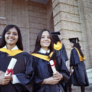 Two Pretty Indian College graduates happy after getting degree in the campus.